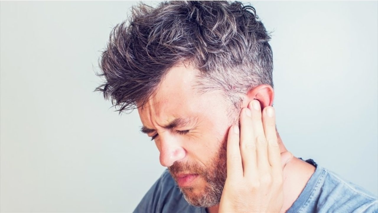 man suffering from tinnitus due to car accident