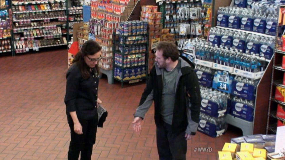 man showing woman spot of slip and fall at a grocery store
