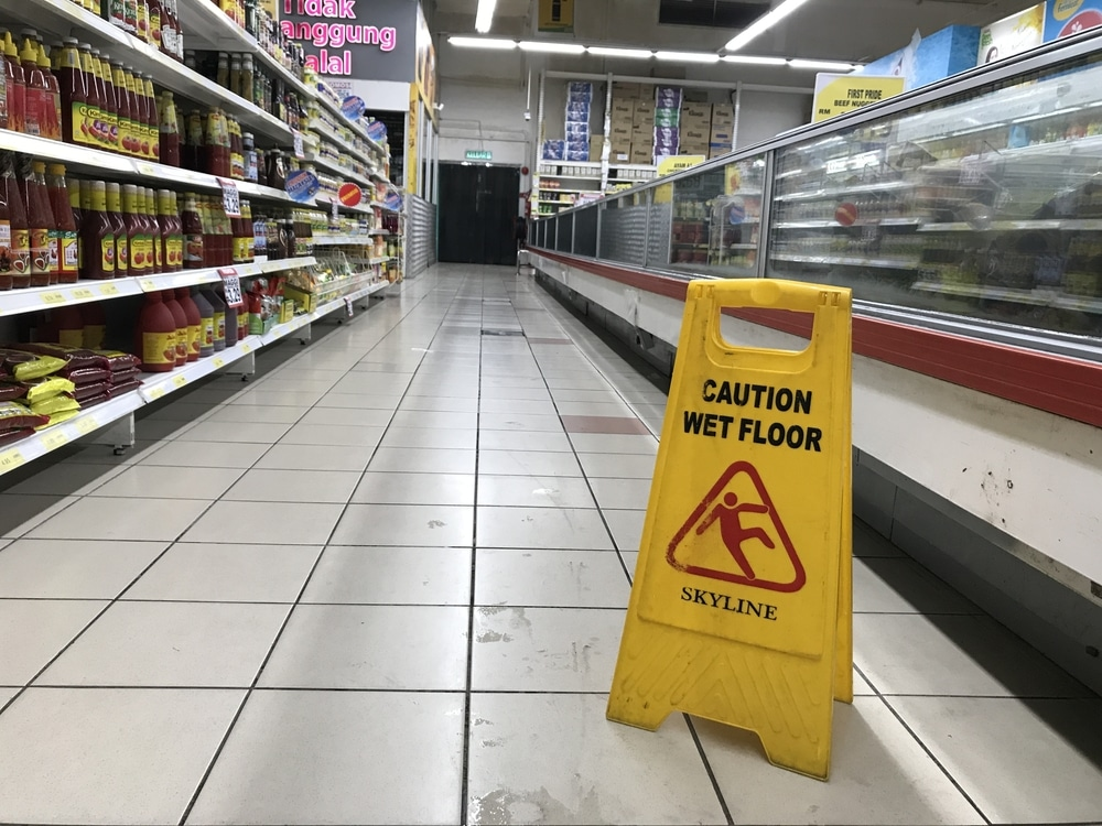 wet floor sign showing slip hazard at grocery store