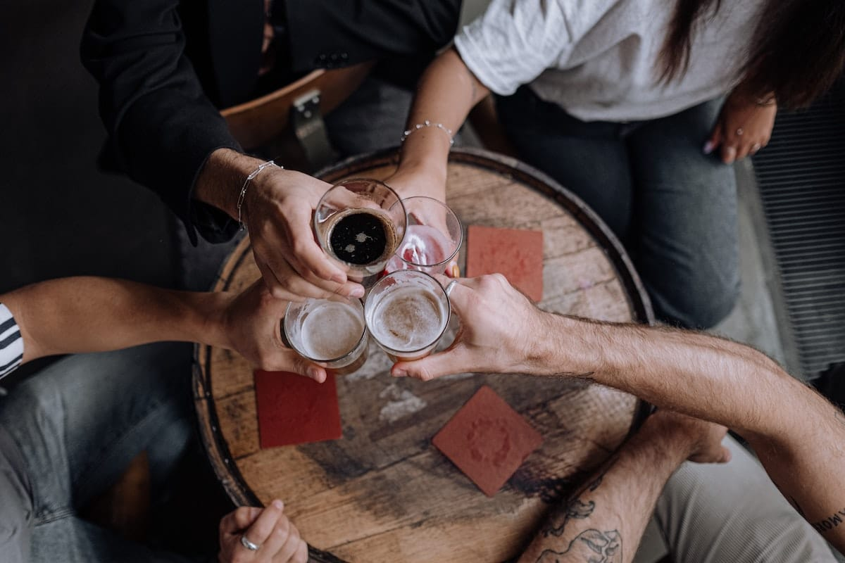 Group of people drinking beer at a Missouri dram shop