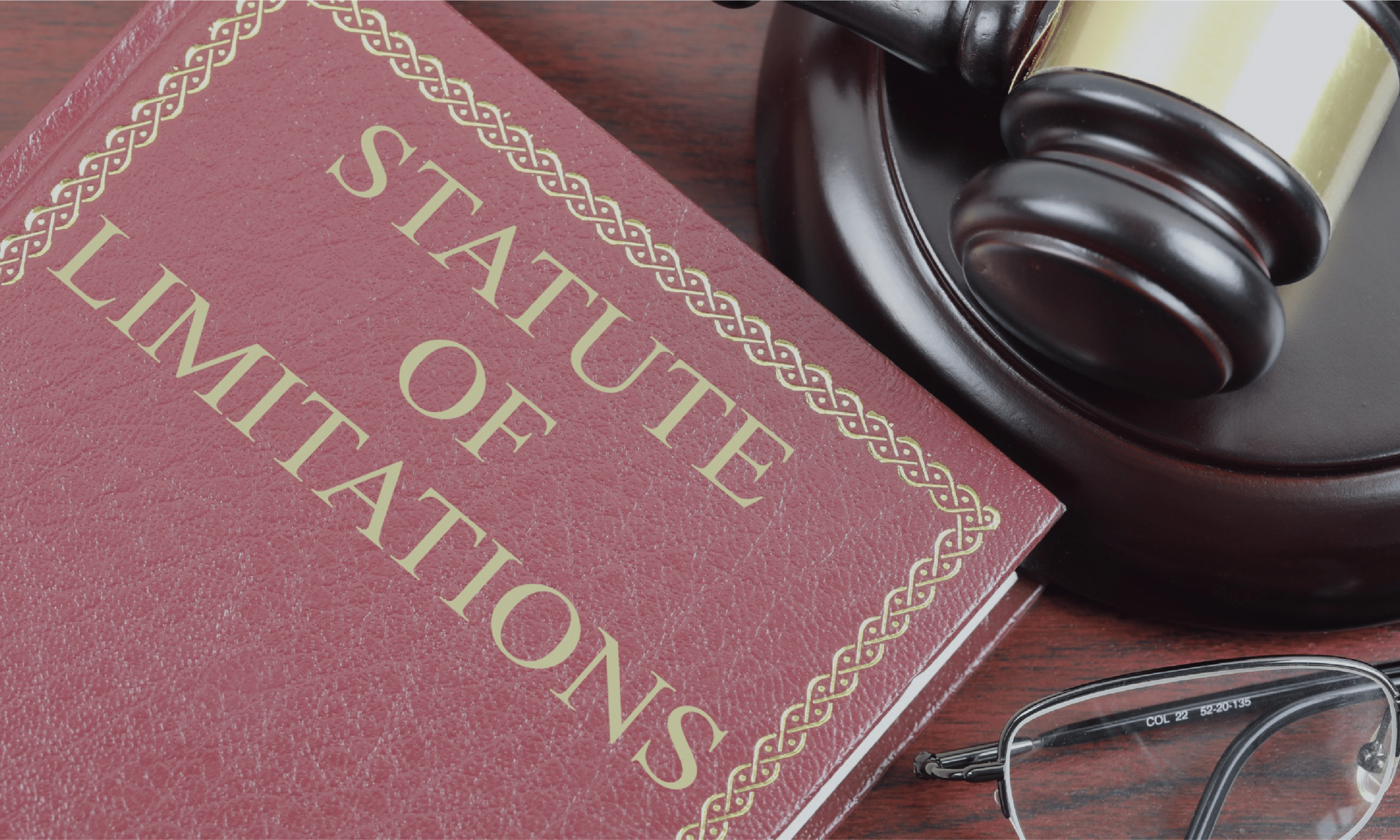 Gavel, glasses and law book on statute of limitations