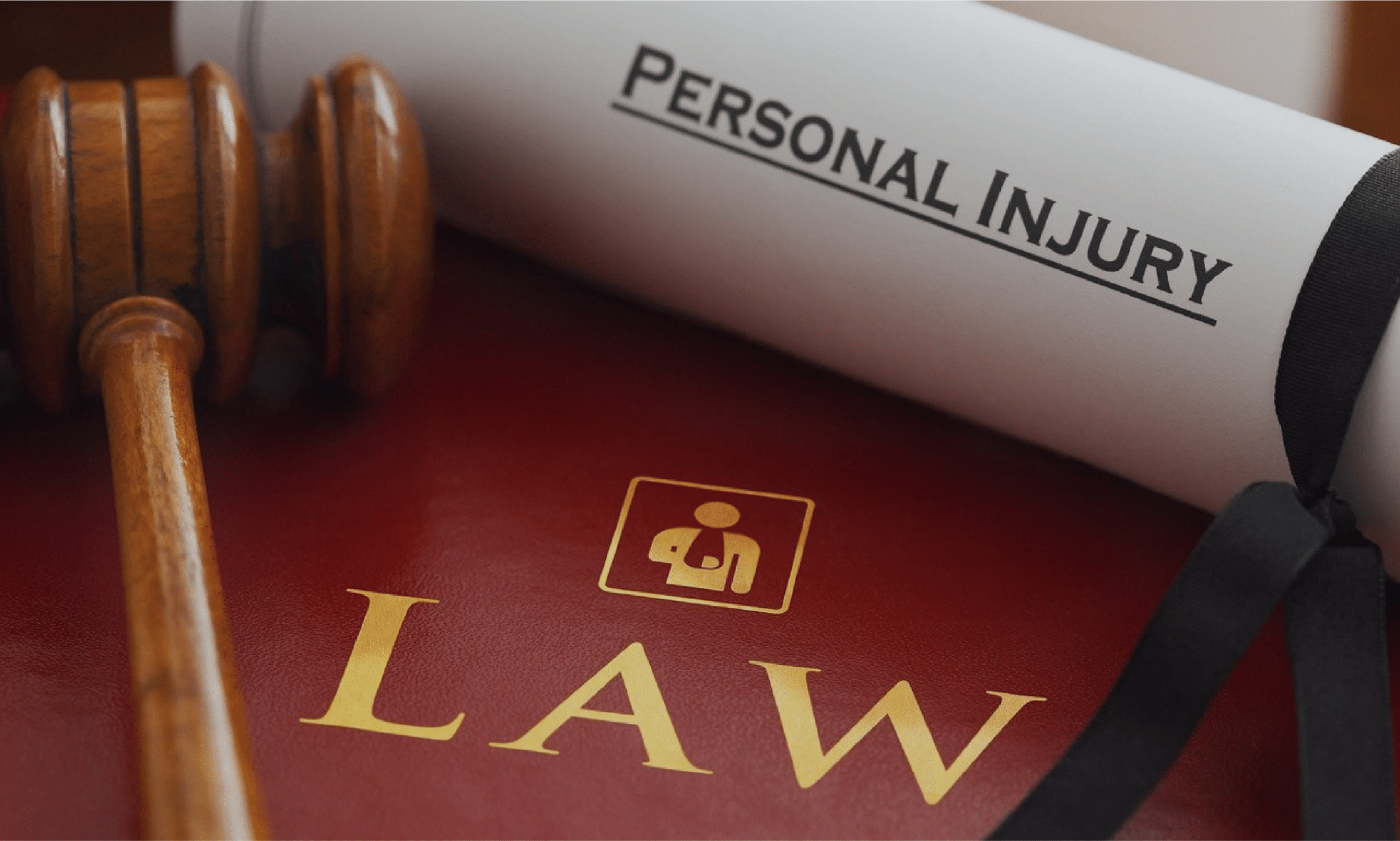 Personal injury law book with gavel