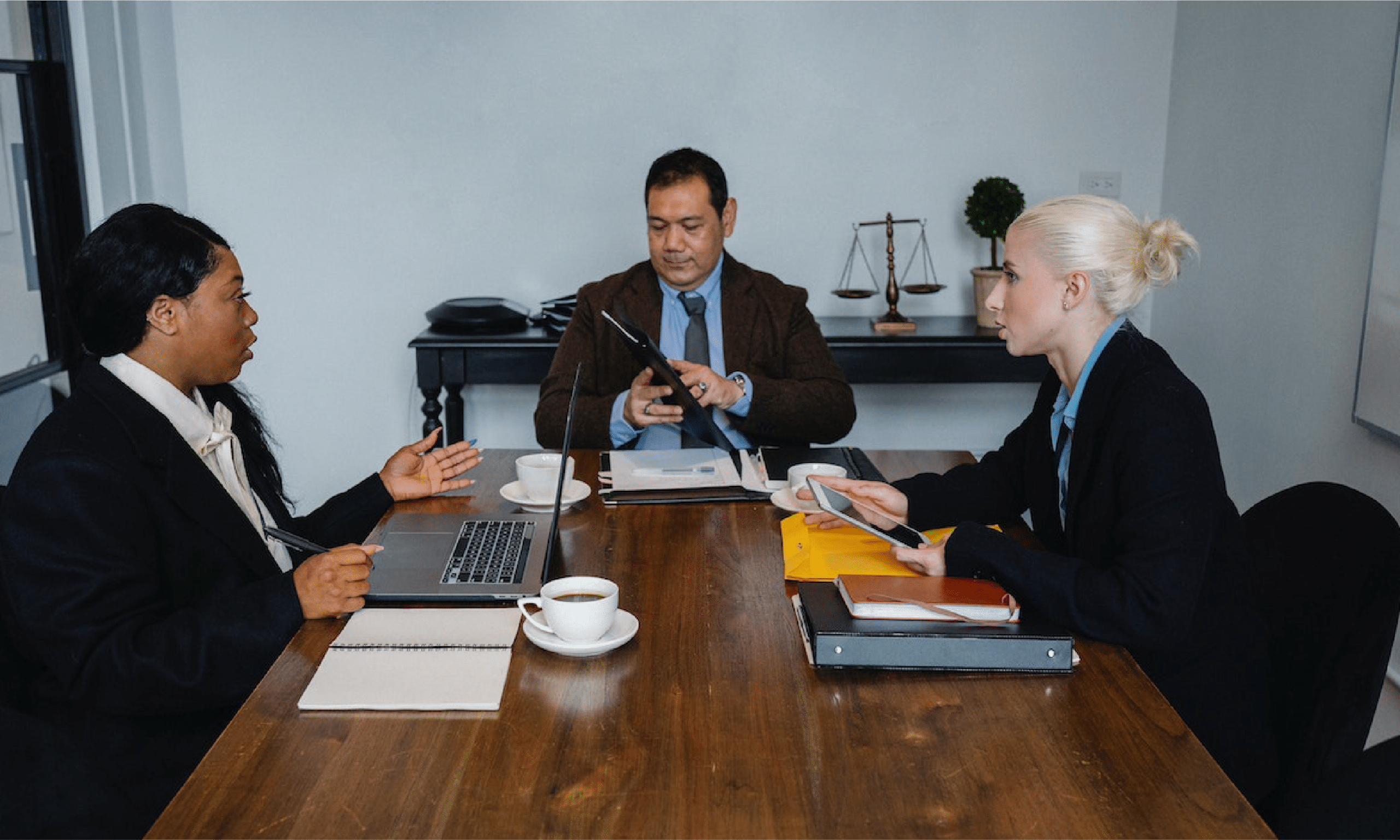 Lawyers and insurance agent negotiating a fair settlement